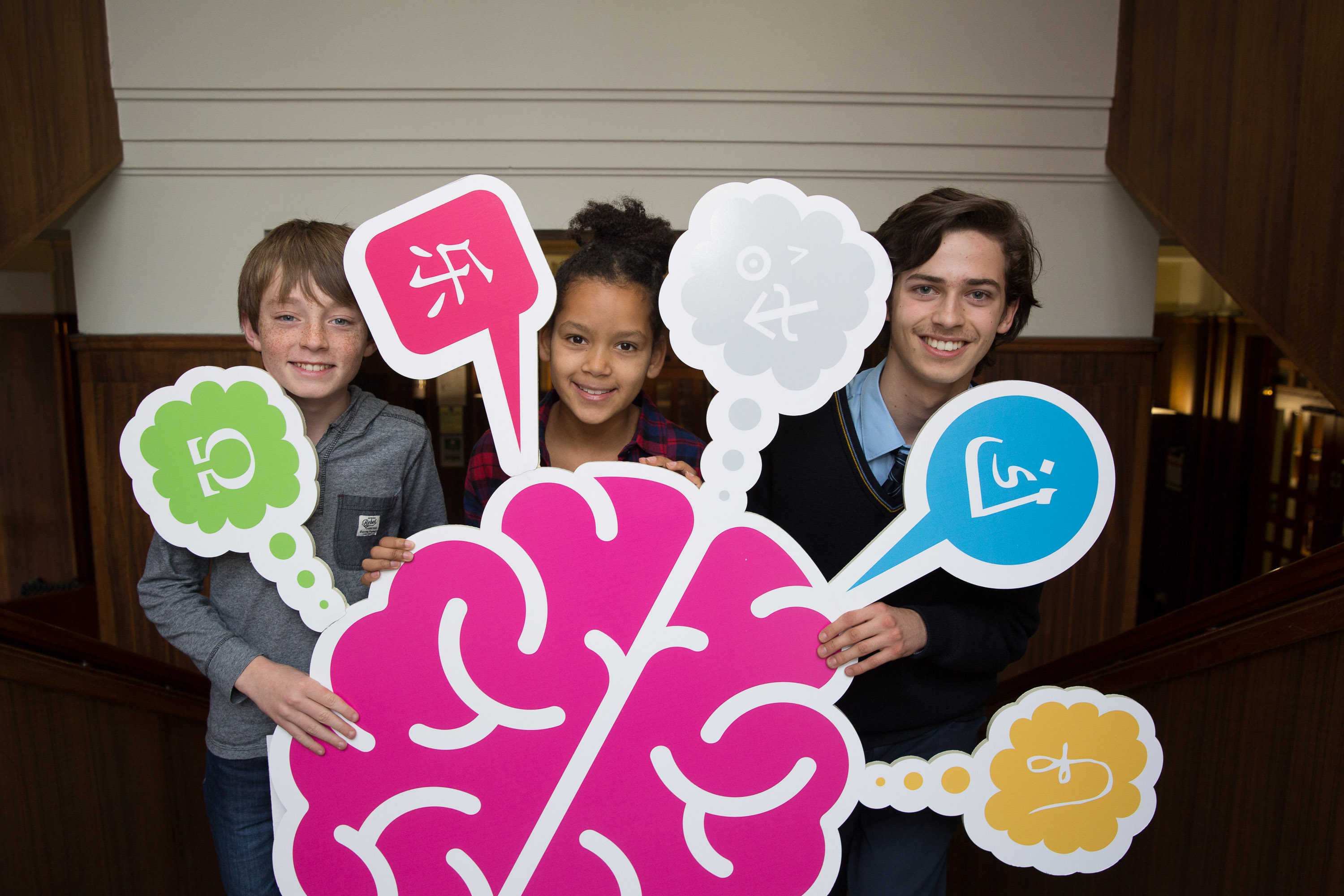 Young students holding cut-out large brain